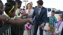 Canadian Prime Minister Justin Trudeau and his wife Sophie Grégoire-Trudeau, and their children, greet students from Paterson Elementary School, in Washington, as they arrive at Andrews Air Force Base, Md., Wednesday, March 9, 2016. (Cliff Owen/AP)