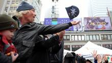 Sir Richard Branson tosses a Virgin Mobile toque to the crowd during an event at Yonge and Dundas Square in Toronto. (Fred Lum/Fred Lum/THE GLOBE AND MAIL)