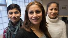 Syrian refugees, Zina Moustafa, centre, her son Wahid Yousef, left, 13, and daughter Riham Yousef, 15, pose for a photograph during an interview with The Globe and Mail at the Surrey School District English Language Learner Welcome Centre, in Surrey, B.C., on Thursday December 15, 2016. (DARRYL DYCK/THE GLOBE AND MAIL)