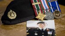 A photo of Cpl. Stuart Langridge is seen along with his beret and medals on a table during a news conference on Parliament Hill in Ottawa on Oct. 28, 2010. A last-minute witness has been added to the public hearing into the suicide of a Canadian soldier and that is prompting a flurry of objections from federal lawyers. Mark Freiman, who represents the Military Police Complaints Commission, says the witness came forward just recently and has something relevant to add to the investigation into the handling of Cpl. Stuart Langridge's death. (Adrian Wyld/THE CANADIAN PRESS)