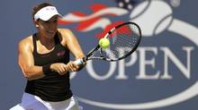 Sharon Fichman of Canada hits a return to Agnieszka Radwanska of Poland during their match at the 2014 U.S. Open tennis tournament in New York, August 25, 2014. (ADAM HUNGER/REUTERS)