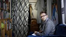 Canadian author, Lee Henderson, works on sketching in his office at home in Victoria, B.C. September 9, 2014. (CHAD HIPOLITO/THE GLOBE AND MAIL)