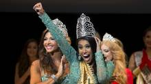 """Ashley Burnham of Canada reacts as she wins the """"Mrs Universe 2015"""" contest in Minsk, Belarus, August 29, 2015. (VASILY FEDOSENKO/REUTERS)"""