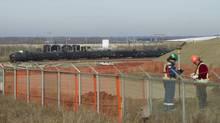 A Canexus terminal that will transfer oil piped in to train cars near Bruderheim, Alberta, is shown in a file photo. Canexus said late Tuesday that delivery of as much as 100,000 barrels per day of Cold Lake bitumen blend to the rail terminal was delayed, pushing startup of the facility from a Sept. 1 target. (IAN JACKSON/NYT)