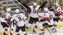 In a redemptive playoff performance, Ottawa Senators' Bobby Ryan scores the overtime winner on Pittsburgh Penguins goalie Marc-Andre Fleury in Game 1 of the Eastern Conference final on Saturday. (Don Wright/USA Today Sports)