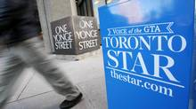 A pedestrian walks past a Toronto Star newspaper box in front of the Toronto Star building at One Yonge Street in Toronto. (MARK BLINCH/REUTERS)
