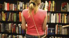 A woman browses in a bookstore, something that happens a lot in one week in Canada. (chris sadowski/iStockphoto)