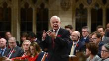 Minister of Immigration, Refugees and Citizenship John McCallum stands during question period in the House of Commons on Parliament Hill in Ottawa on Monday, Oct. 31, 2016. (Sean Kilpatrick/THE CANADIAN PRESS)