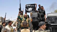 Iraqi security forces hold up a flag of the Islamic State in Iraq and the Levant on Saturday. In order to fight back against ISIL, countries that consider one another hostile are now associated as allies. (STR/AP)