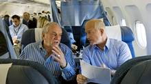 NDP Leader Jack Layton goes over his speaking notes with Ed Broadbent aboard the campaign plane in Toronto on Oct. 10, 2008. (Nathan Denette/The Canadian Press)