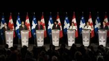 NDP leadership candidates, from left, Nathan Cullen, Thomas Mulcair, Paul Dewar, Martin Singh, Niki Ashton, Peggy Nash and Brian Topp attend an NDP leadership debate in Montreal, Sunday, March 4, 2012. (Graham Hughes/The Canadian Press/Graham Hughes/The Canadian Press)