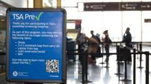 This undated image released by the Transportation Security Administration shows a sign promoting the TSA PreCheck program at at Reagan National Airport in Washington. (AP Photo/TSA) (The Associated Press)