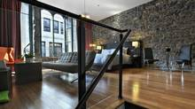The hotel brings contemporary style into a classic Old Montreal building, blending exposed stone and sleek bamboo floors.