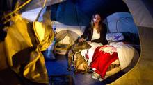 Andrea Sparre, who is studying to be a vet tech, with her dog Spike in her tent at the current site of the Nickelsville tent city in Seattle January 26, 2011. (John Lehmann/The Globe and Mail/John Lehmann/The Globe and Mail)