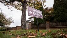 A real estate for sale sign is pictured in front of a home in Vancouver, British Columbia on October 4, 2016. (Ben Nelms/The Globe and Mail)
