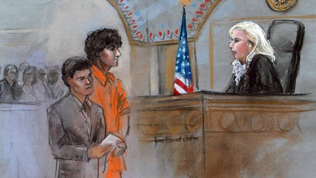 This courtroom sketch depicts Boston Marathon bombing suspect Dzhokhar Tsarnaev standing with his lawyer Miriam Conrad, left, before Magistrate Judge Marianne Bowler, right, during his arraignment in federal court on July 10, 2013 in Boston. (Jane Flavell Collins/AP)