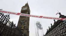 A singles white rose, a tribute to the victims of Wednesday's attack, is placed near the Houses of Parliament in London, Thursday March 23, 2017. (Tim Ireland/AP)