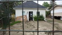 A house in Riverside Villas in High River, Alta., is vacant and severely damaged, as seen on July 23, 2013. (Chris Bolin For The Globe and Mail)