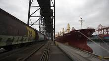 A wheat train pulls up next to a cargo ship at the Alliance Grain Terminal in Vancouver. (BEN NELMS/REUTERS)