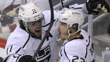 Los Angeles Kings right wing Dustin Brown (23) celebrates his 3rd period goal against the Phoenix Coyotes with teammate Anze Kopitar (11) during Game 1 of the NHL Western Conference hockey finals in Glendale, Arizona, May 13, 2012. REUTERS/Todd Korol (TODD KOROL)
