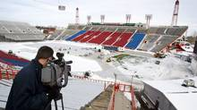 A cameraman films the installation of the ice surface in preparation for the NHL Heritage Classic in Calgary, Alta., Thursday, Feb. 10, 2011. The Calgary Flames will play the Montreal Canadiens on Feb. 20 in the second NHL outdoor game of the 2010/2011 season. (Jeff McIntosh/THE CANADIAN PRESS)
