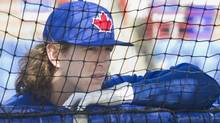 Toronto Blue Jays' Colby Rasmus waits outside the batting cage at the team's MLB baseball spring training facility in Dunedin, Florida February 16, 2013. (FRED THORNHILL/REUTERS)