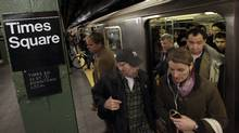 Passengers exit a downtown-bound, west side subway train in New York's Times Square, Thursday, Nov. 1, 2012 (Richard Drew/The Associated Press)