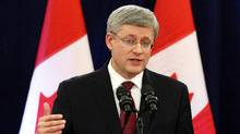 Canada's Prime Minister StephenHarperspeaks during a news conference about foreign takeovers on Parliament Hill in Ottawa, Dec. 7, 2012./ (Chris Wattie/Reuters)