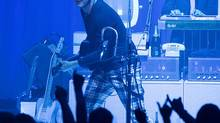 Jack White, seen here performing in Seattle on Monday, offers a performance that's infused with improvisation and experimentation. (David James Swanson)