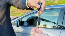 handing over keys of new car buyer (kosmos111/Getty Images/iStockphoto)