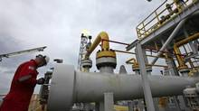 The failure to allow Petrobras to raise domestic gasoline and diesel prices in line with world prices prompted its first loss in 13 years in the second quarter of 2012, and added more than $8-billion in 2012 losses at its refining unit. (SERGIO MORAES/REUTERS)