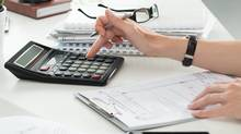 Close up of female accountant or banker making calculations. Savings, finances and economy concept (Dutko/Getty Images/iStockphoto)