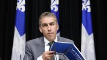 Quebec's Minister of Finance Nicolas Marceau listens to a question during a presentation on the economic update for the 2012-13 provincial budget at the National Assembly in Quebec City. (MATHIEU BELANGER/REUTERS)