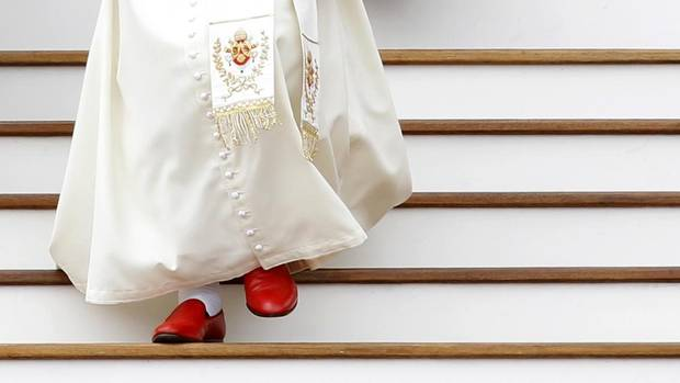 Pope Benedict XVI leaves at the end of his weekly general audience in St. Peter's Square in this May 19, 2010 file picture. Pope Benedict will step down on Feb. 28. At Gammarelli, a discreet oak-panelled tailor's shop in central Rome, they are expected to be already creating vestments for the new pope – in a range of sizes. (ALESSANDRO BIANCHI/REUTERS)