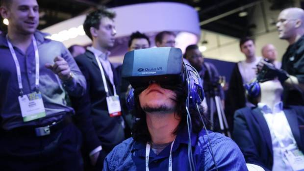 This is how the machines take over, they convince us we don't need our real eyes. Show attendees play a video game wearing Oculus Rift virtual reality headsets at the Intel booth at the International Consumer Electronics Show on Tuesday, Jan. 7, 2014, in Las Vegas. (Jae C. Hong/AP)