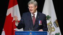 Canadian Prime Minister Stephen Harper delivers a speech to the recipients of the Queen's Diamond Jubilee Medal in Calgary, Alberta, October 9, 2012. (TODD KOROL/REUTERS)