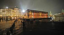 "A giant Louis Vuitton trunk, 30-metres long and 9-metres high, put up in Moscow's Red Square to house an upcoming Louis Vuitton exhibition ""The Soul of Travel"". Proceeds from the ticket sales will go to Natalia Vodianova's Naked Heart Foundation (Sergei Bobylev/ITAR-TASS)"