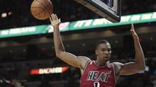 Miami Heat's Chris Bosh descends after dunking in the first half of their NBA basketball game against the Portland Trail Blazers in Miami, Florida February 12, 2013. (Andrew Innerarity/REUTERS)