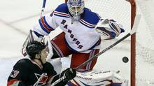 Carolina Hurricanes' Jeff Skinner (53) tries to score as New York Rangers goalie Henrik Lundqvist defends the goal during the third period of an NHL hockey game in Raleigh, N.C., Saturday, April 6, 2013. (Gerry Broome/AP)