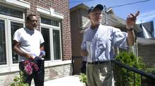 Progressive Conservative candidate Doug Holyday, right, speaks to resident Mayank Sharma, 38, in Etobicoke, Ontario Friday, July 26, 2013. (Kevin Van Paassen/The Globe and Mail)