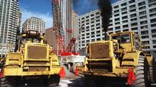 Caterpillar construction loaders operate side by side at a Central Artery construction site in Boston, in this file photo. (PATRICIA MCDONNELL/AP)