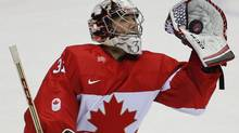 Canada goaltender Carey Price snags a shot against Finland in the first period of a men's ice hockey game at the 2014 Winter Olympics, Sunday, Feb. 16, 2014, in Sochi, Russia. (Julio Cortez/AP)