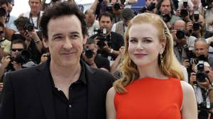 Cast members Nicole Kidman (R) and John Cusack pose during a photo call for the film