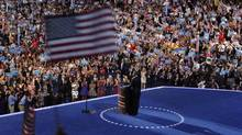 A delegate waves a U.S. flag as President Barack Obama addresses delegates and accepts the 2012 U.S Democratic presidential nomination during the final session of the Democratic National Convention in Charlotte, N.C., on Sept. 6, 2012. (LARRY DOWNING/REUTERS)