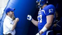 Danny Maciocia (L), coach of University of Montreal Carabins football team greets offensive linesman David Foucault prior to their opening game against the McGill Redmens on September 1, 2011. (Christinne Muschi/The Globe and Mail)