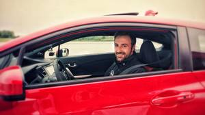 IndyCar driver James Hinchcliffe seated in a Civic Coupe Si on the track at the Canadian Tire Motorsport Park in Bowmanville, Ont. on Tuesday, July 15, 2014.