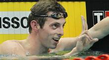 Canada's Ryan Cochrane celebrates winning the gold medal in the men's 1500m freestyle final during the Commonwealth Games at the Dr. S.P. Mukherjee Aquatics Center in New Delhi, India, Saturday, Oct. 9, 2010. (AP Photo/Victor R. Caivano) (Victor R. Caivano/AP)