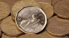 Canadian dollars are pictured in this 2011 file photo. (JONATHAN HAYWARD/THE CANADIAN PRESS)