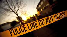 Police tape covers off a the scene of a 2009 shooting in Vancouver. (JOHN LEHMANN/JOHN LEHMANN/THE GLOBE AND MAIL)