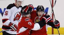 Ottawa Senators centre Jason Spezza, right, celebrates his goal against the New Jersey Devils with teammate Shean Donovan during the first period of their NHL hockey game in Ottawa, January 26, 2010. (CHRIS WATTIE)